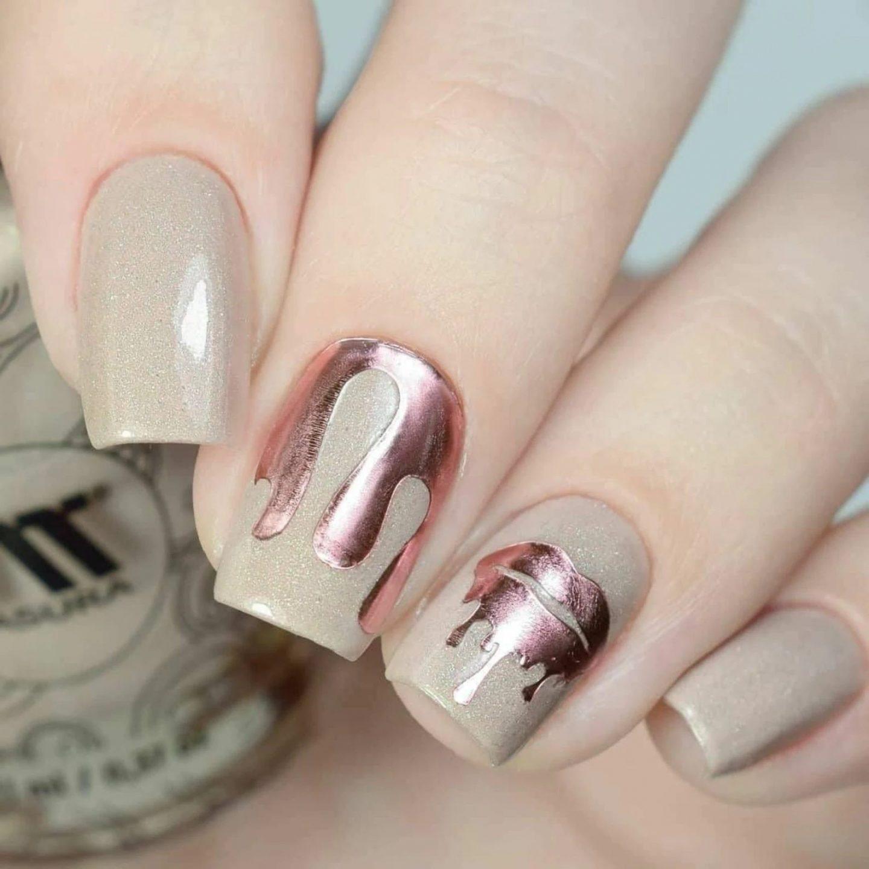 Short nails with rose gold nail art
