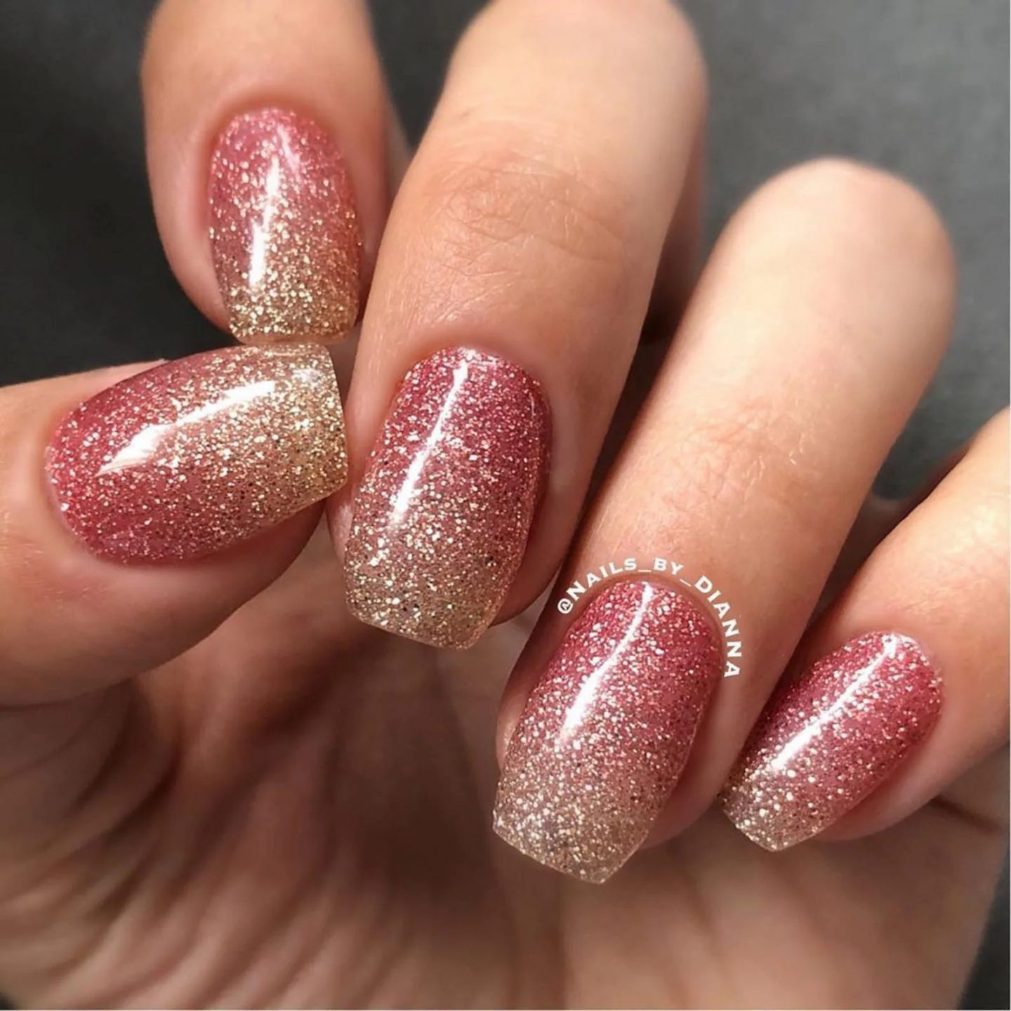 Short rose gold ombre nails with glitter