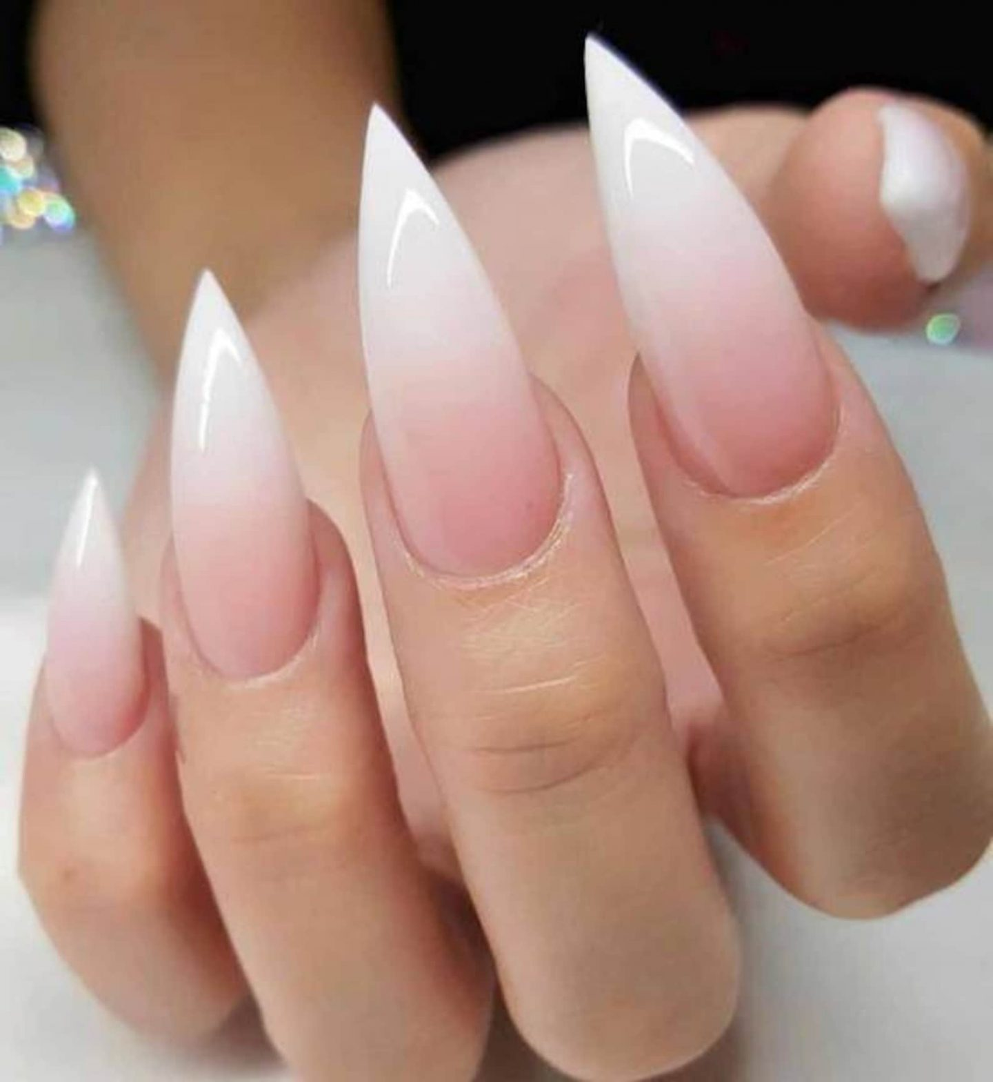 Light pink and white ombre French tip nails in stiletto shape