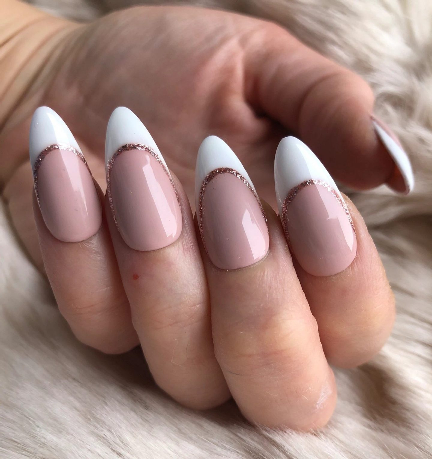 Minimalist French tip nails with rose gold glitter