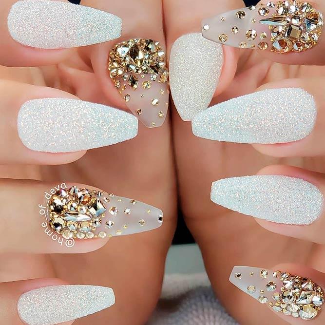 Beautiful white iridescent nails with gold rhinestones