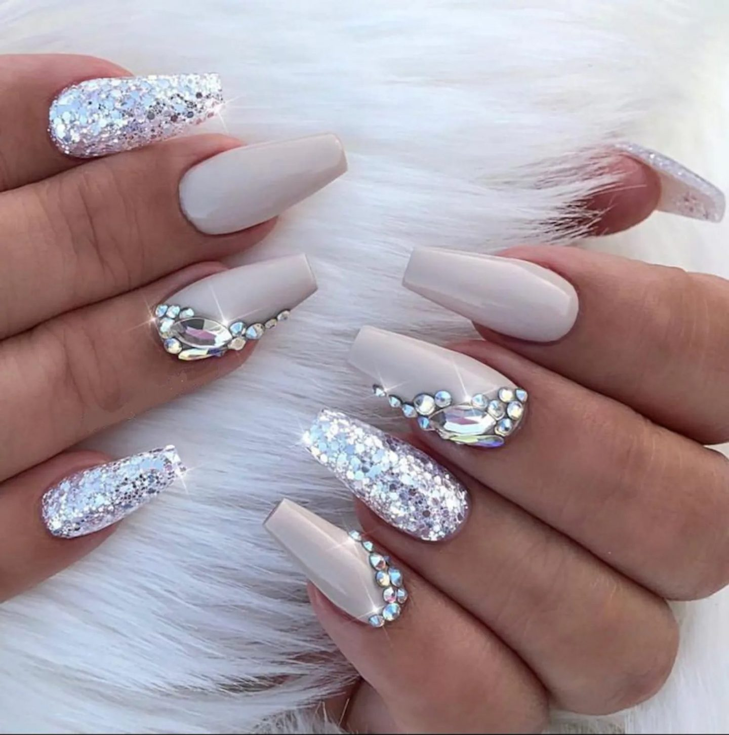 Nude nails with silver glitter and rhinestones