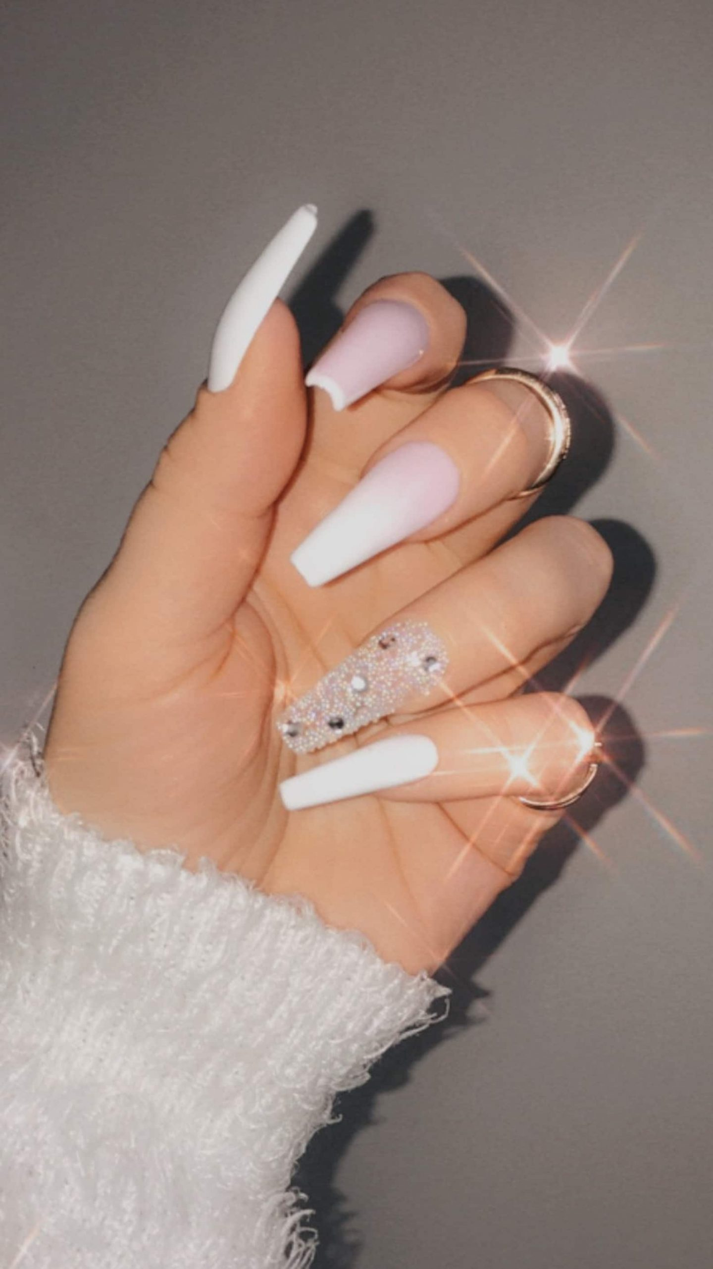 Long white and pink ombre nails with rhinestones