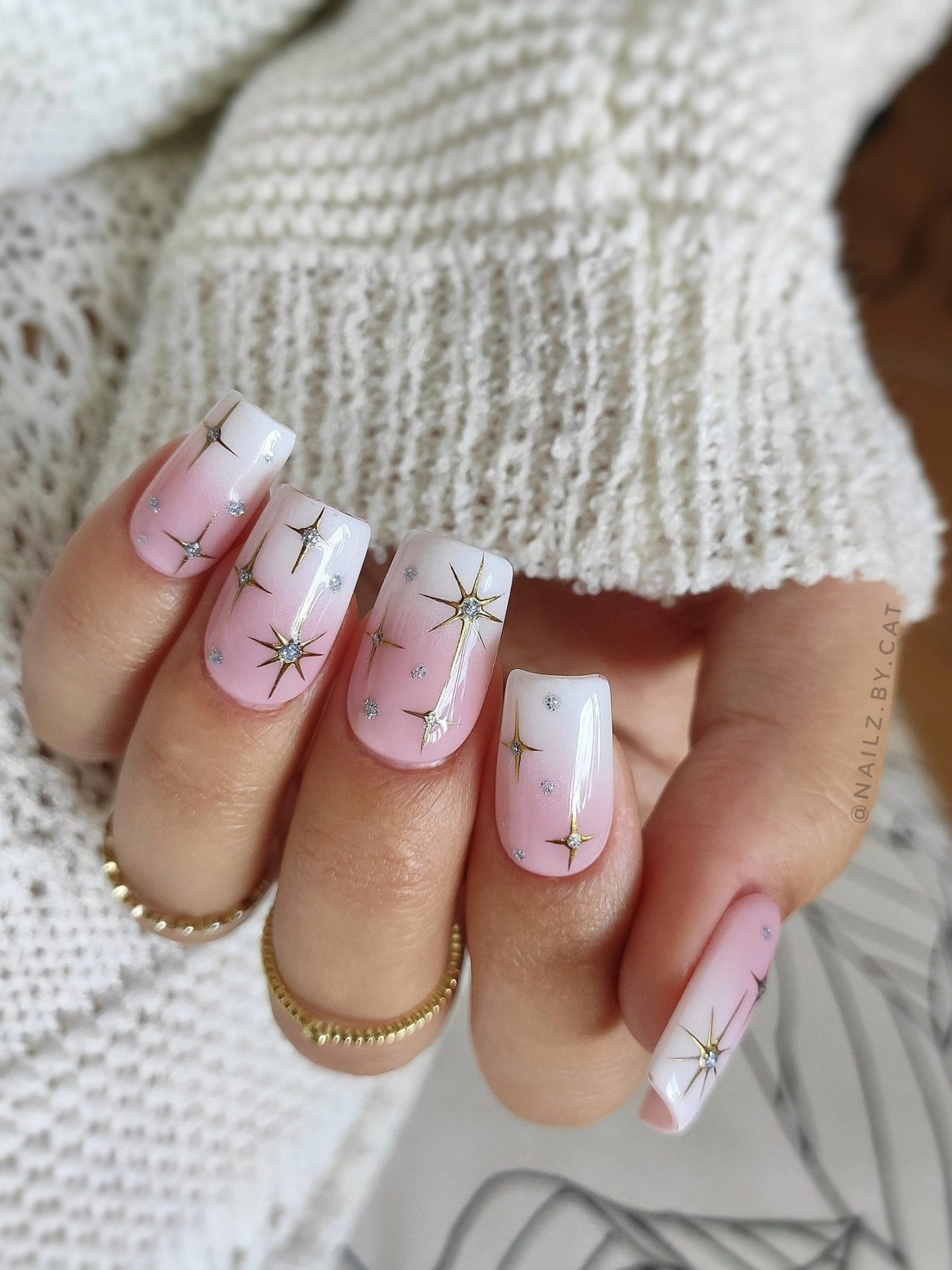 Cute white ombre French tip nails with celestial stars