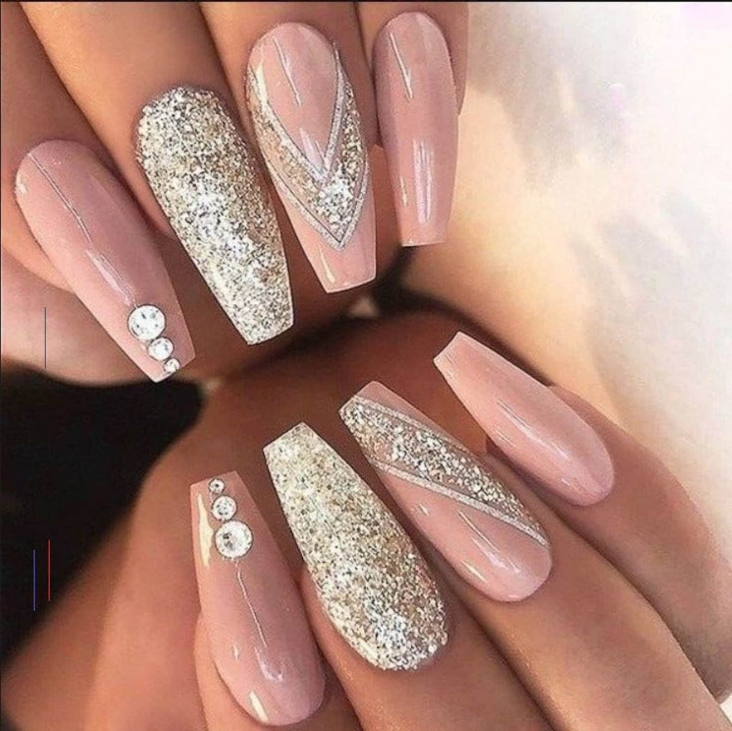 Long pink and champagne gold nails with glitter