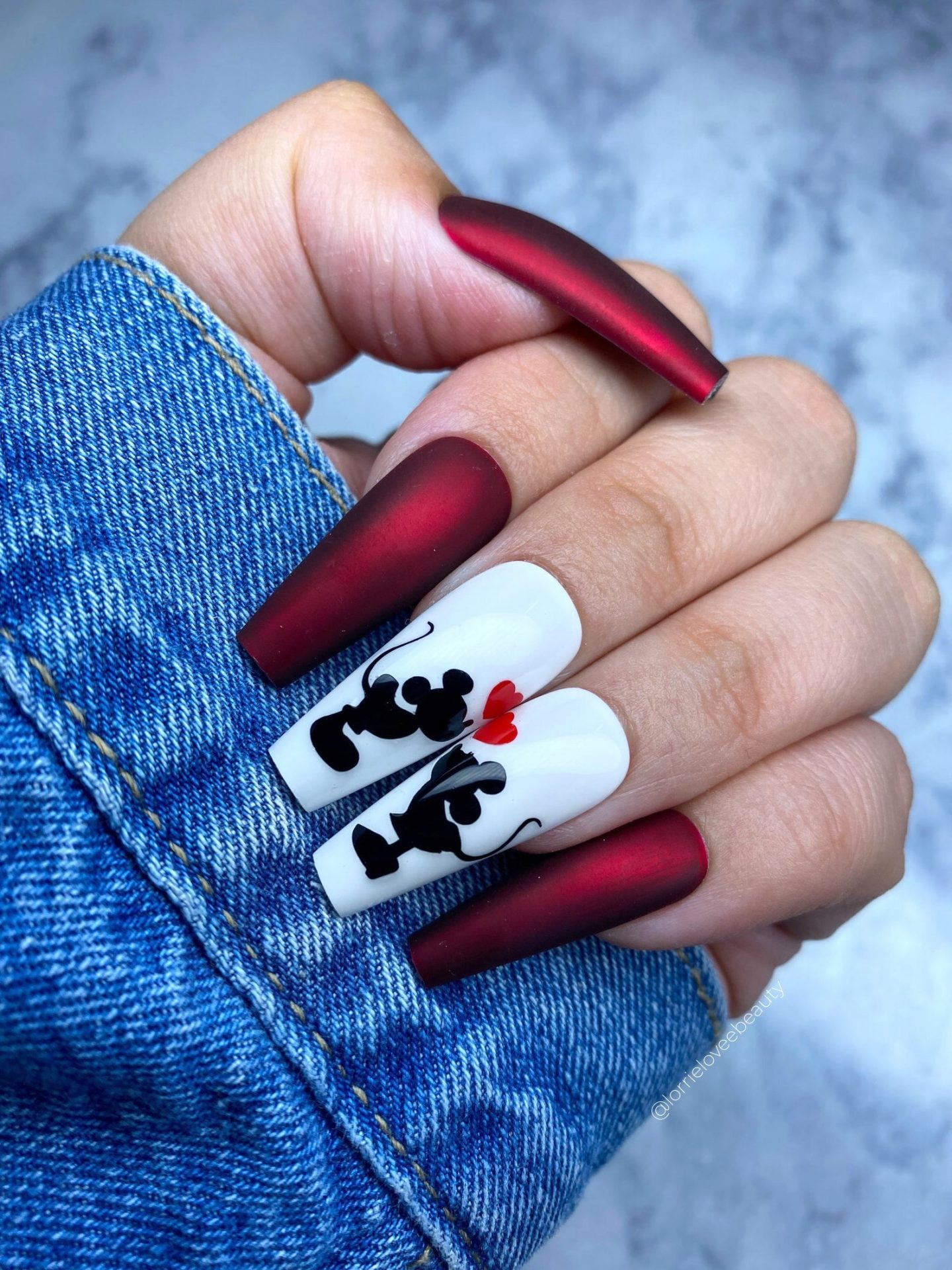 White and metallic red Disney nails with Minnie and Mickey mouse nail art