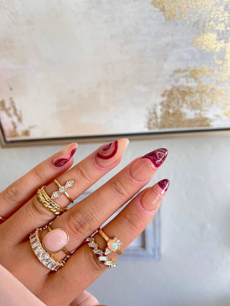 Wavy abstract burgundy nails with French tips