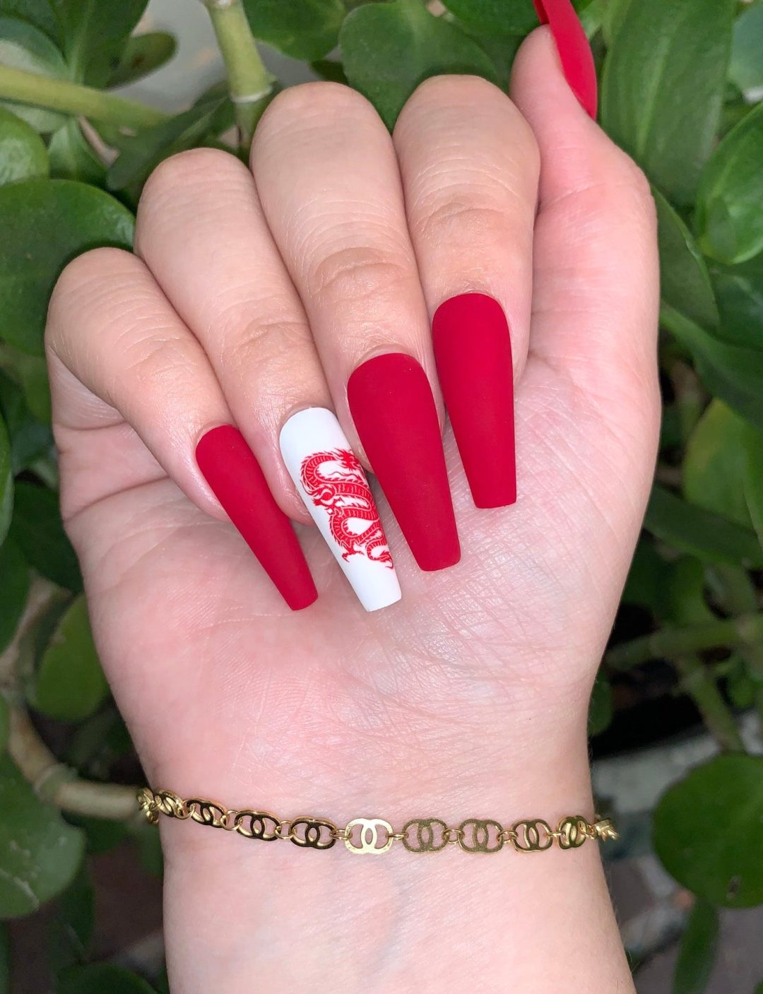 Matte white and red dragon nails