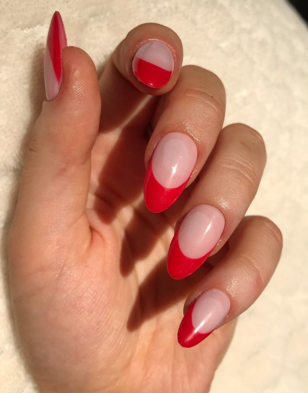 Red French tip nails in almond shape