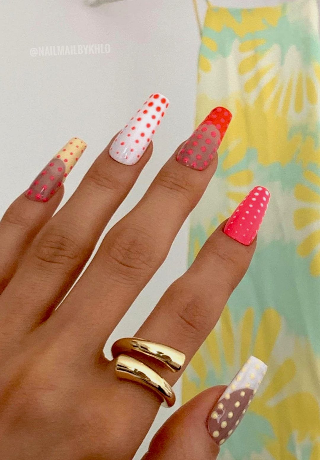 White, pink and red polka dot nails with French tip nails