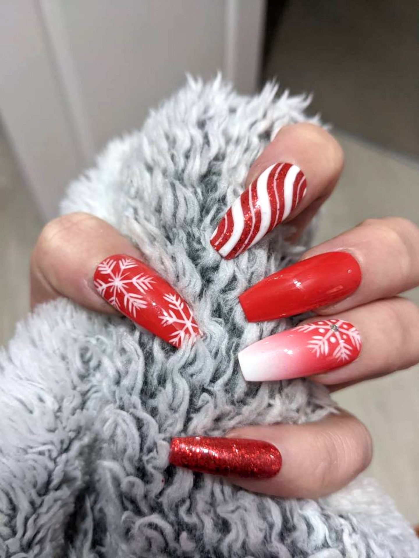 Red Christmas nails with candy cane swirls