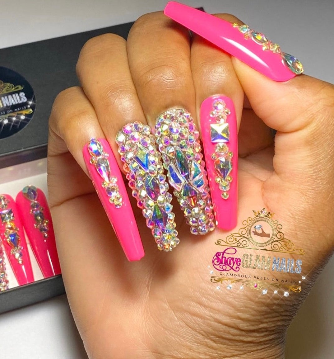 Hot pink nails with rhinestones