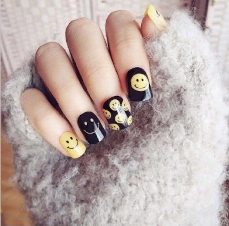 Short black and yellow emoji nails