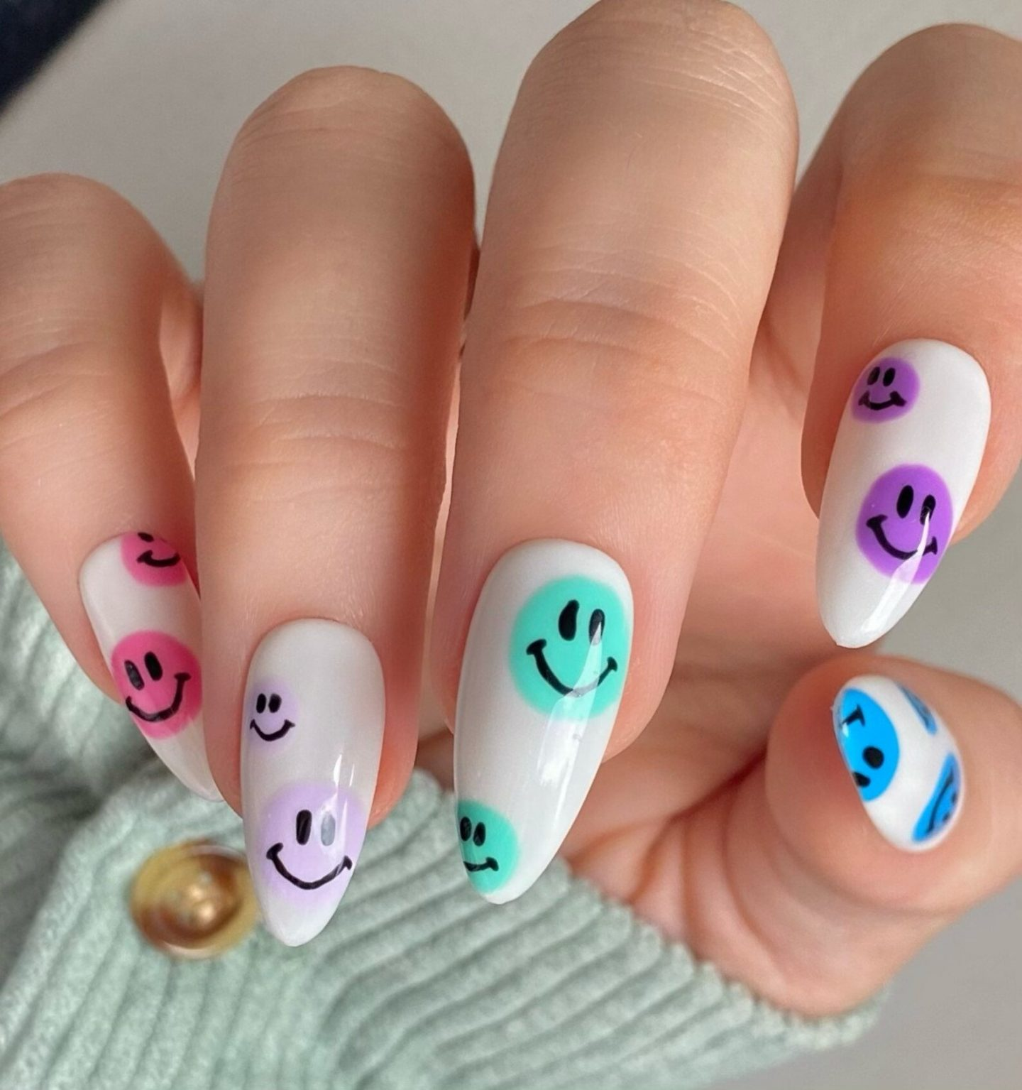 White nails with colorful emojis