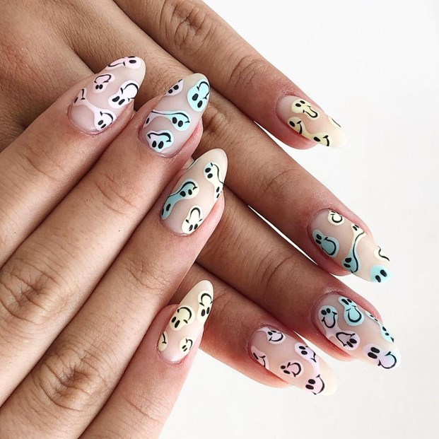Almond nails with pastel smiley nail art