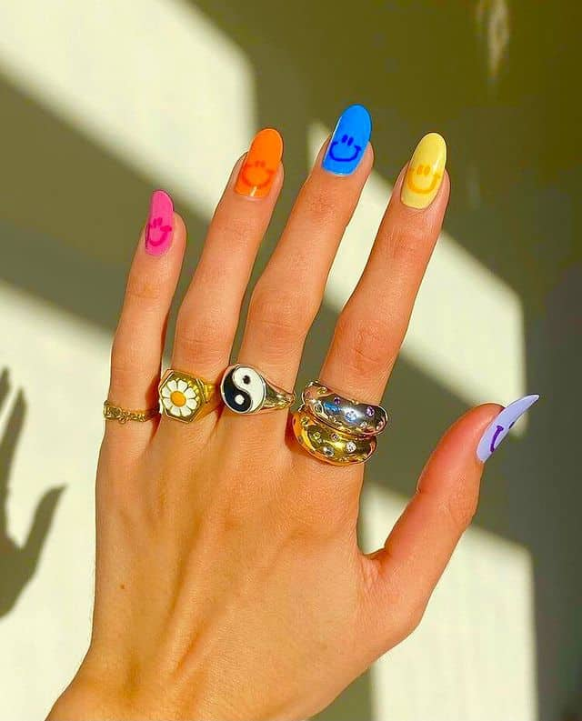 Colorful rainbow smiley face nails