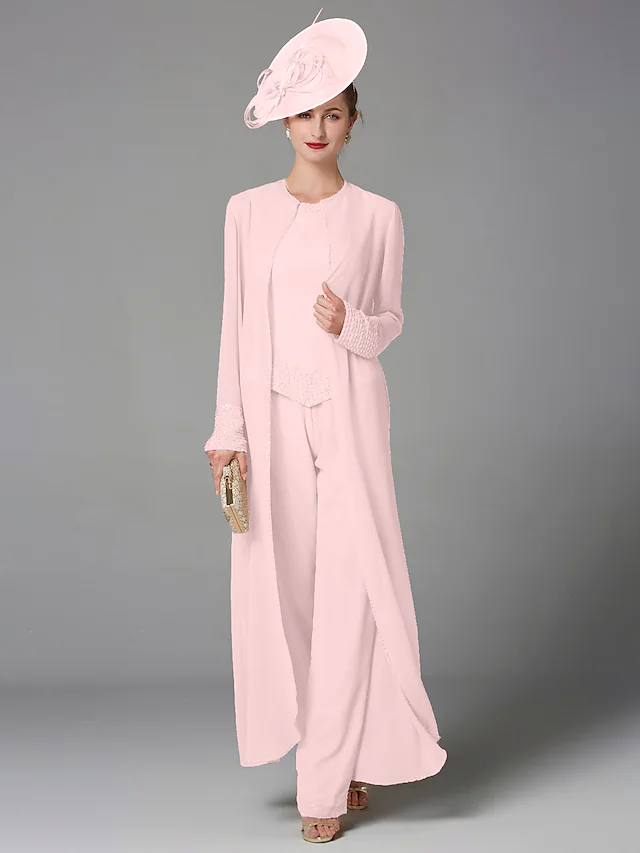 Elegant pink pant suit for mother of groom with facinator