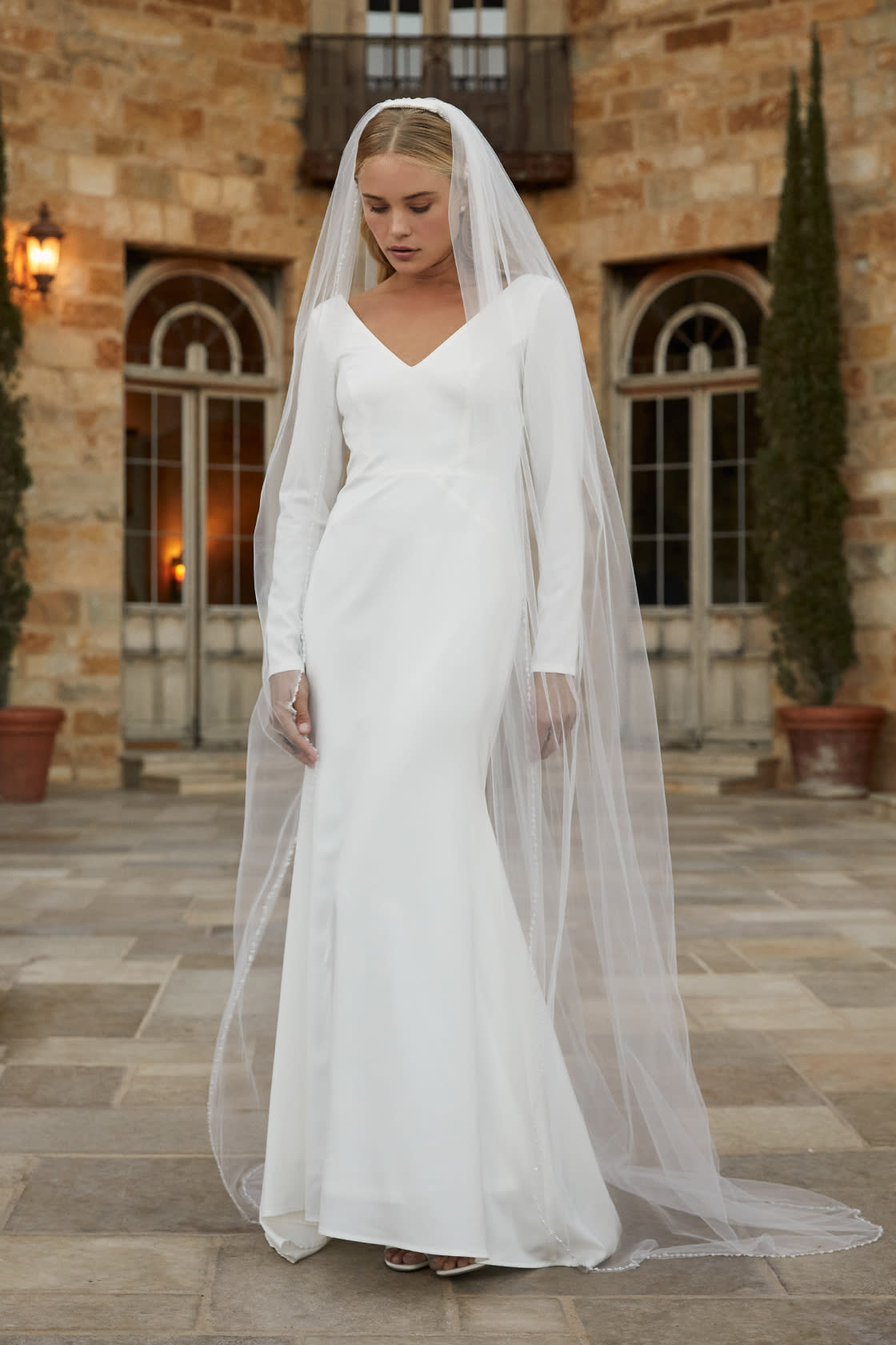 Modest wedding dress with long sleeves and veil