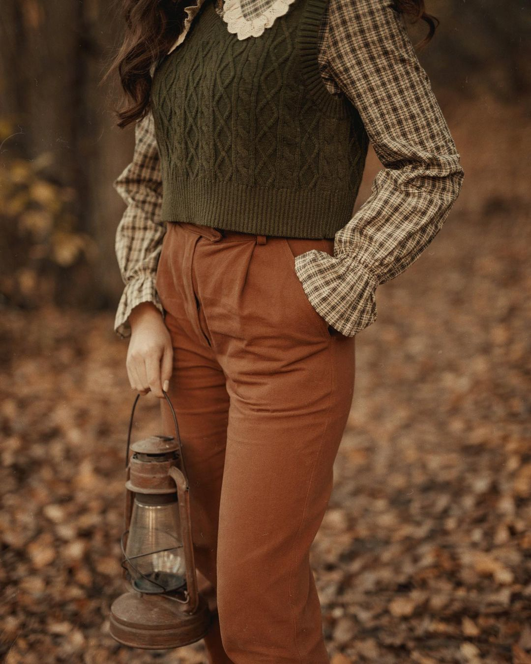 Earthy tone brown pants and green vest for goblincore outfits