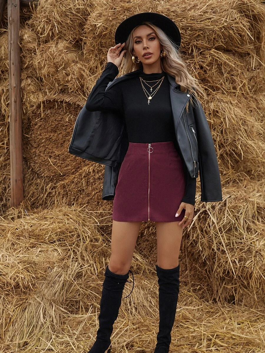 Burgundy corduroy skirt with black top and black leather boots