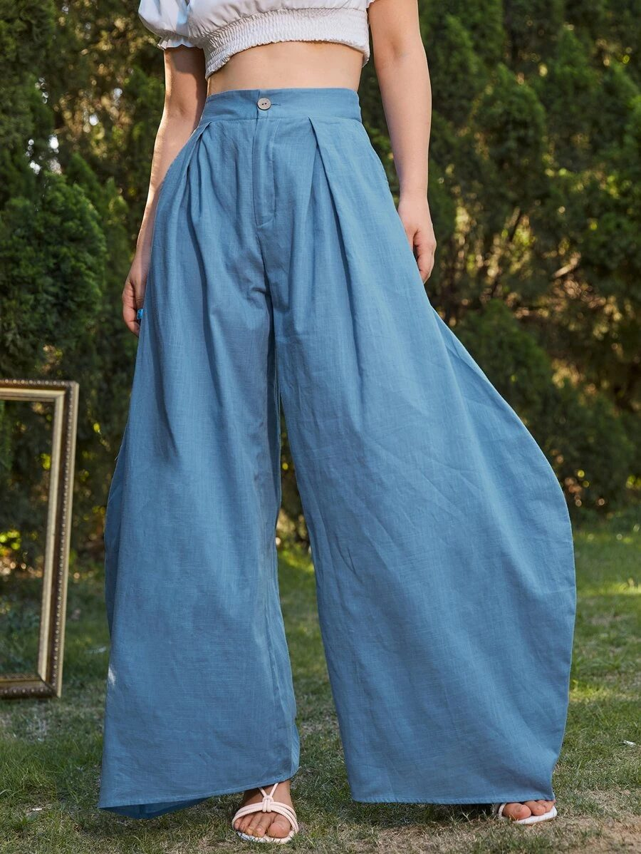 What To Wear To A Boat Party: Blue wide-leg pants