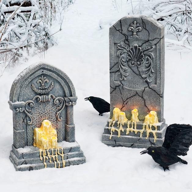 Tombstone With Melting Candles