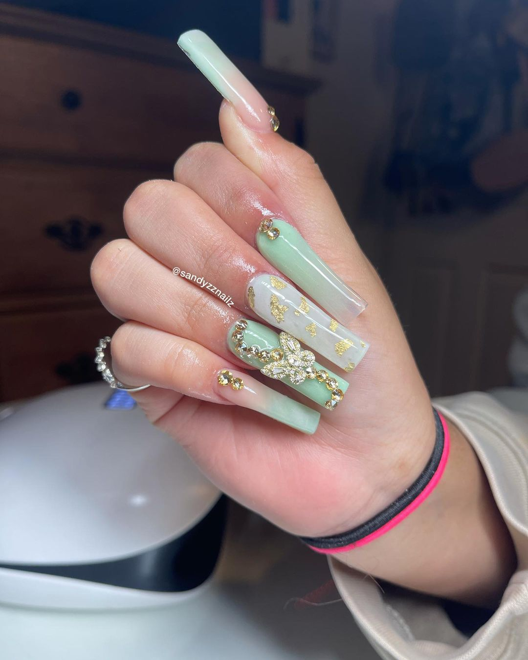 Marble ombre sage green nails with gold decals