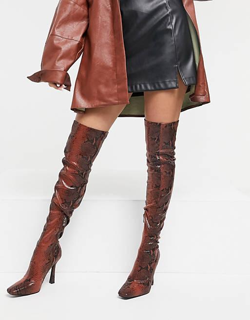 Brown snake print thigh high boots