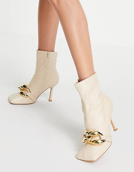 Cream ankle boots with gold details