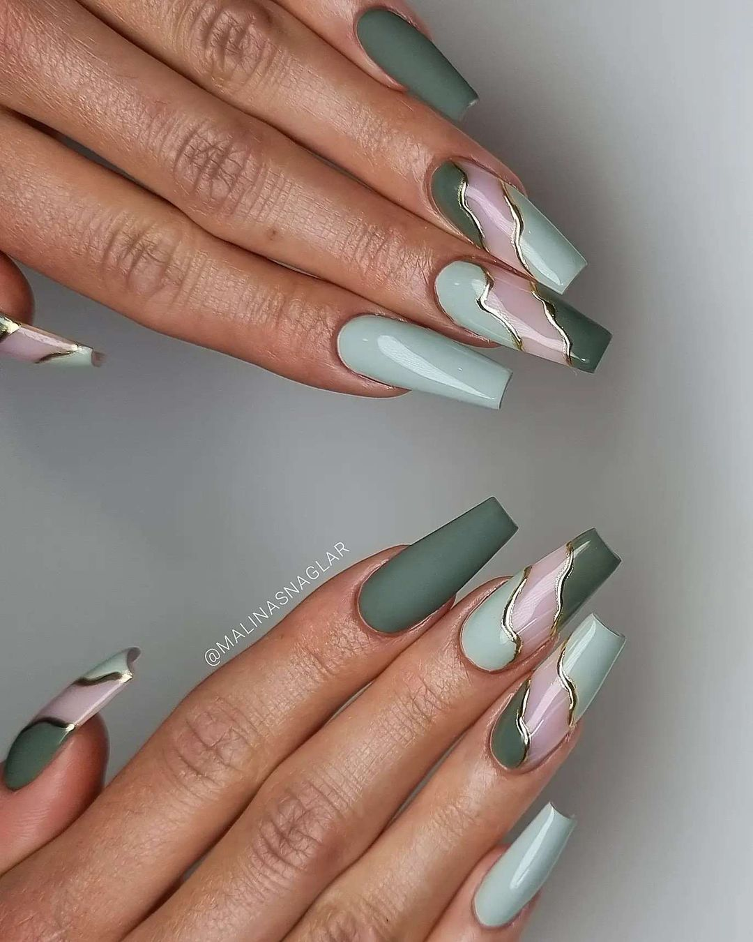 Sage green and pink swirl nails with gold detailing