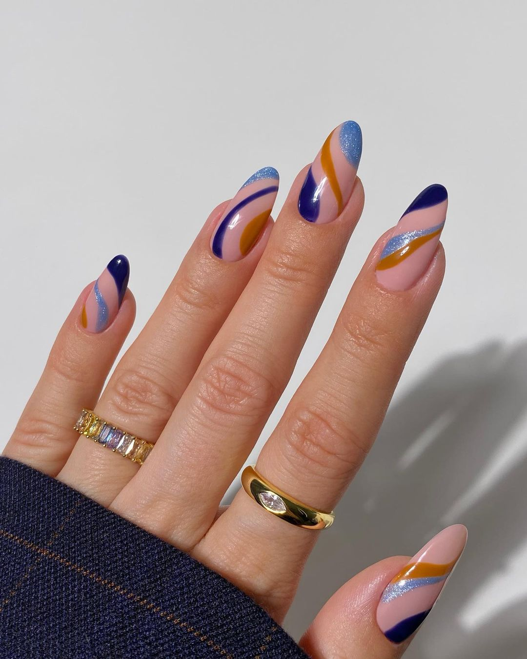Blue and brown swirl nails