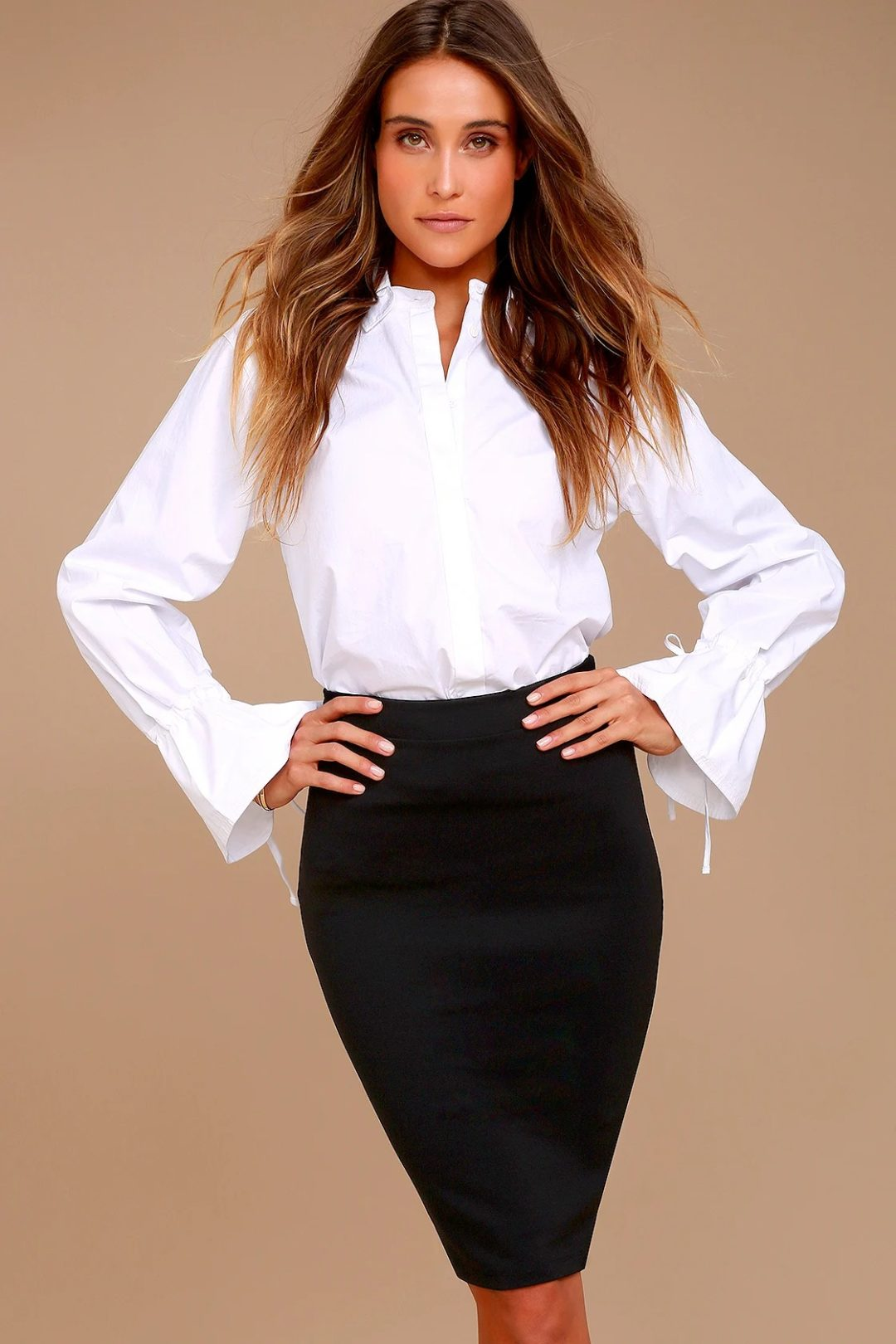White long-sleeved top with black pencil skirt