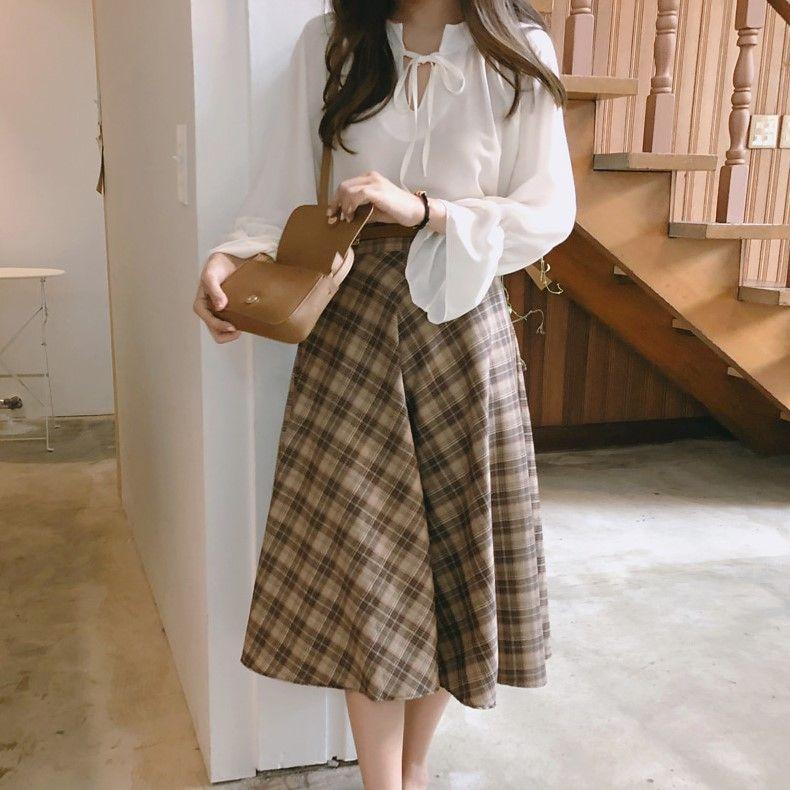 Light Academia Outfits: Plaid midi skirt with white blouse