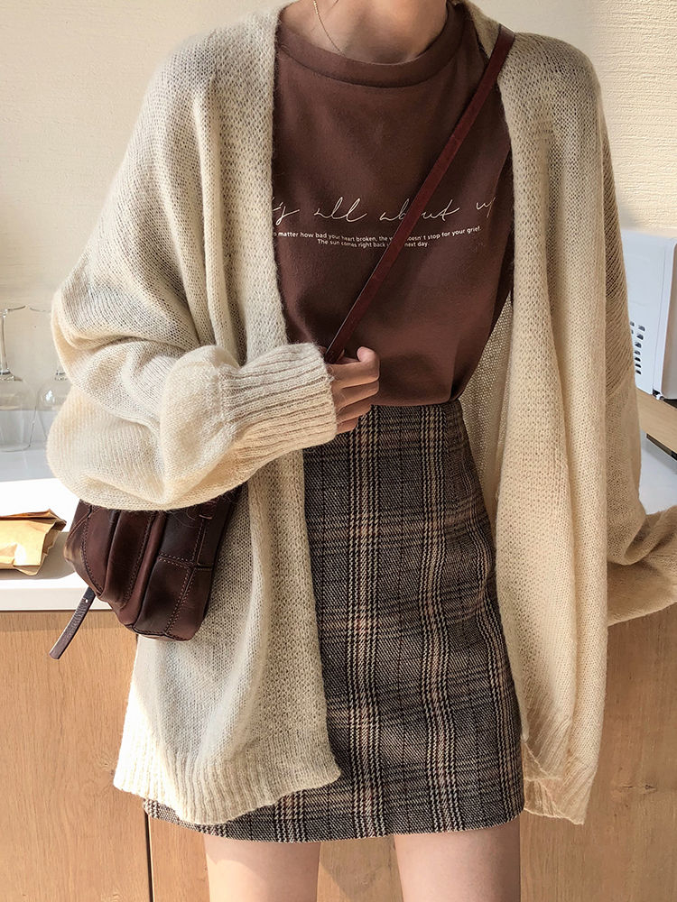Plaid skirt and cream cardigan outfit