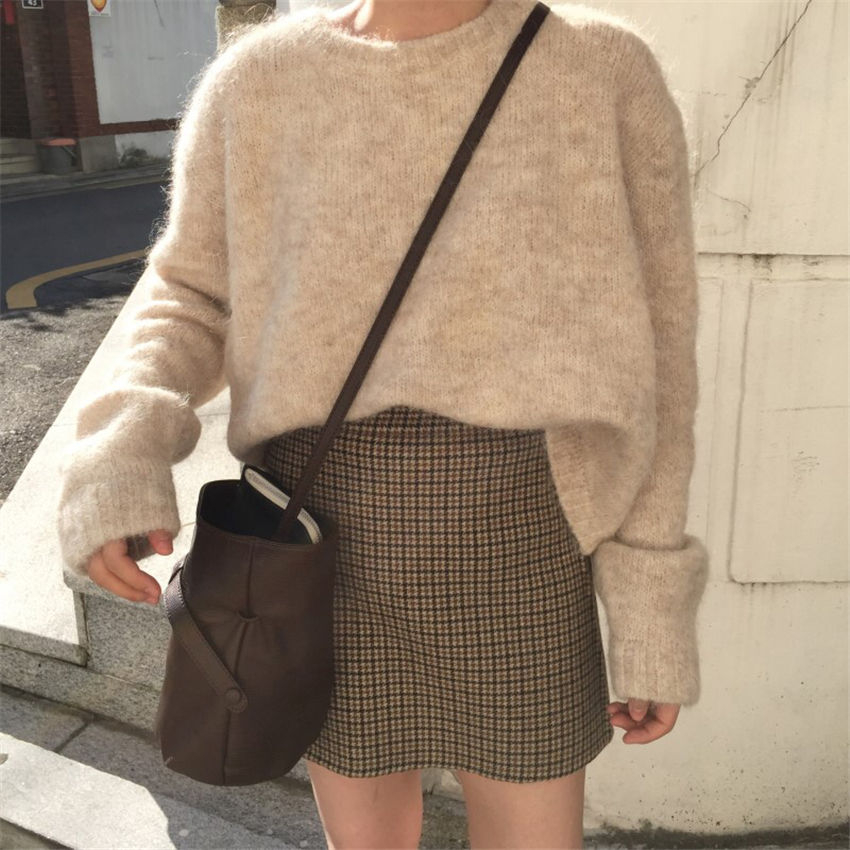Light Academia Outfits: plaid skirt and fuzzy sweater