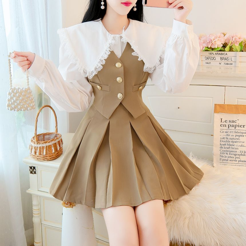 Light Academia Outfits: Brown vest and pleated skirt with white blouse
