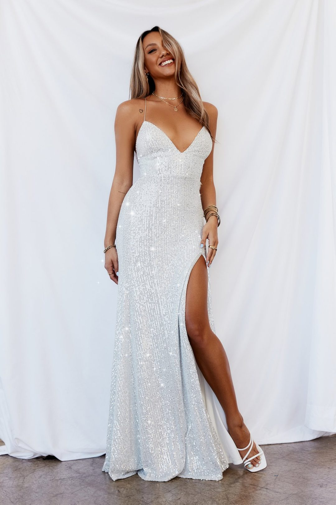 What To Wear At A Masquerade Party: Simple white sequined maxi dress
