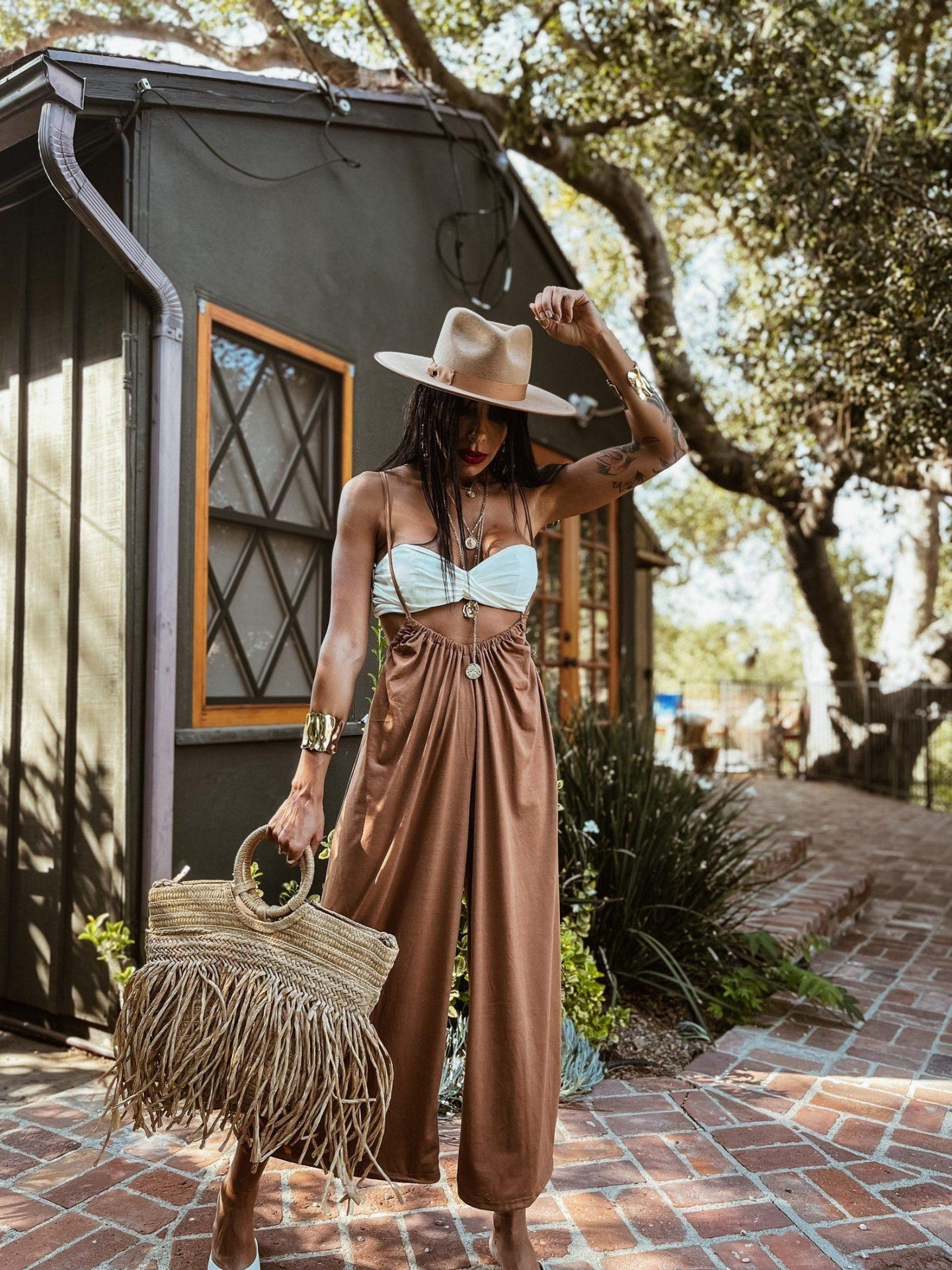 Tan bohemian pants with suspenders and hay bag