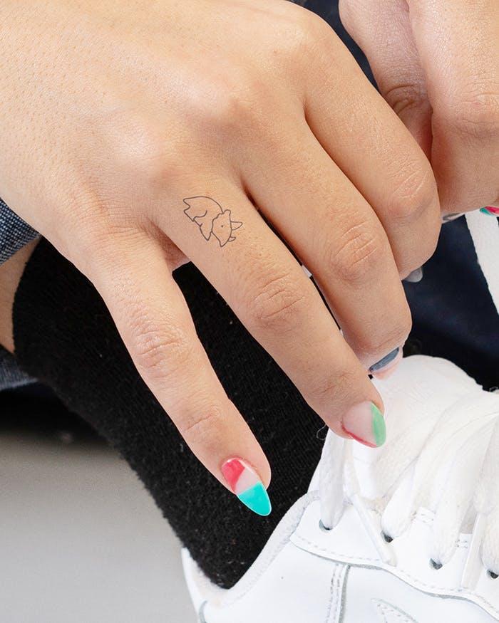 Finger tattoo ideas for females: Minimalistic rhino