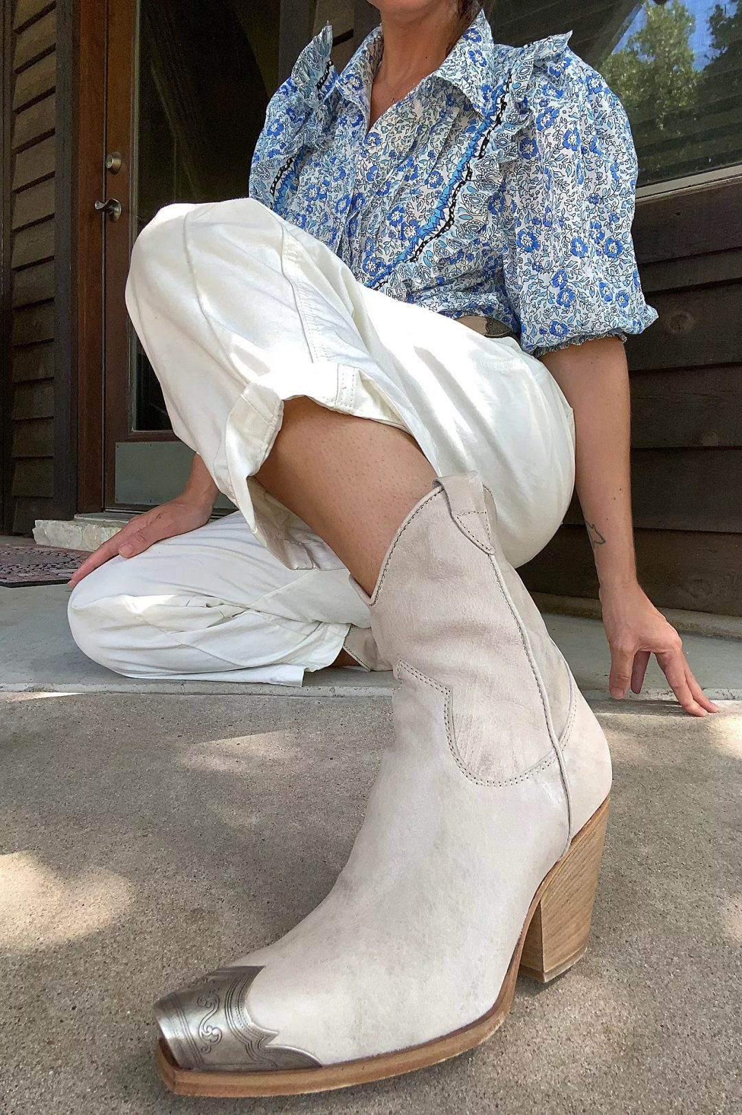 Cute cream Western boots with metallic nose