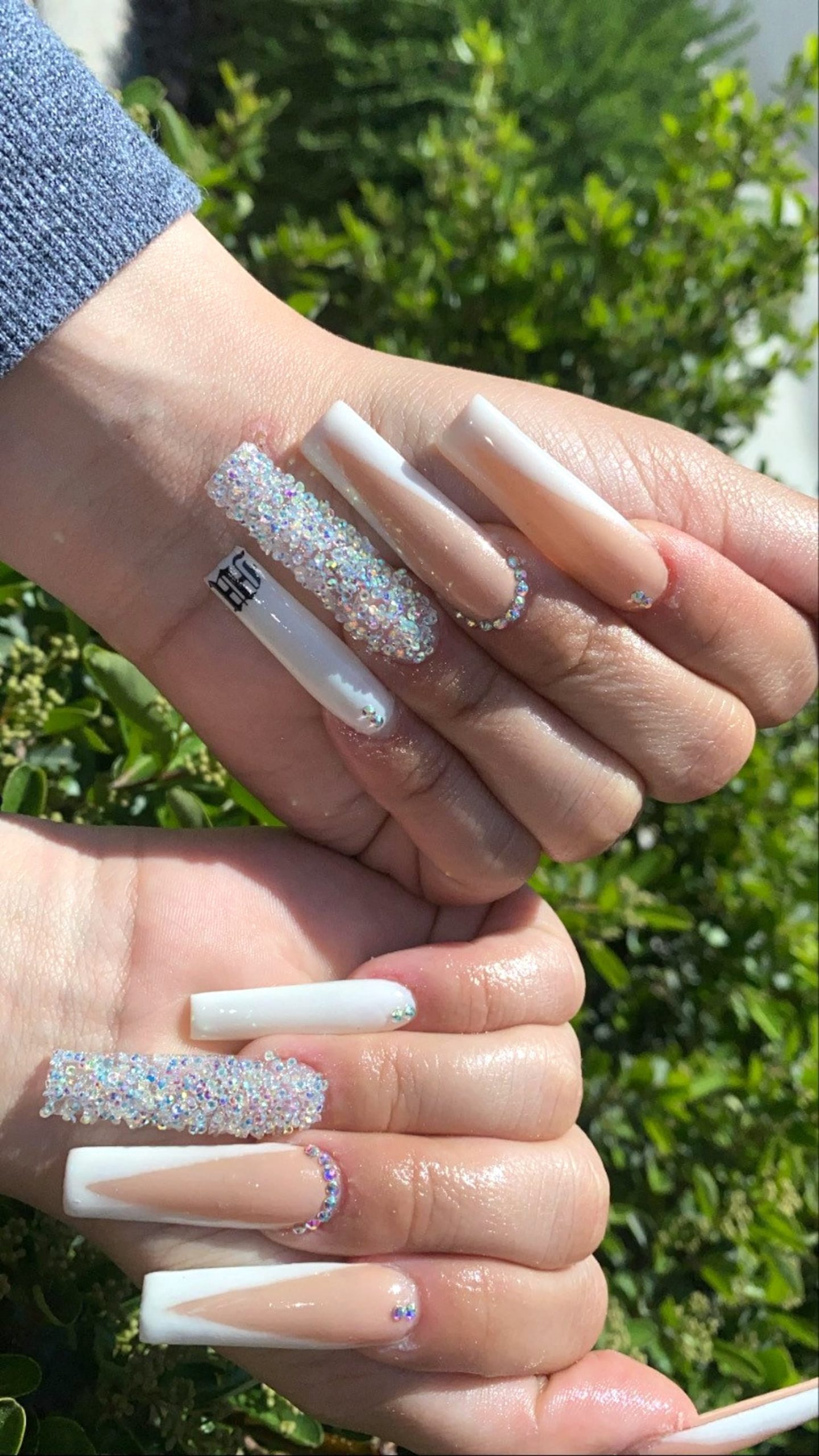 Long icy French tip nails with rhinestones in coffin shape