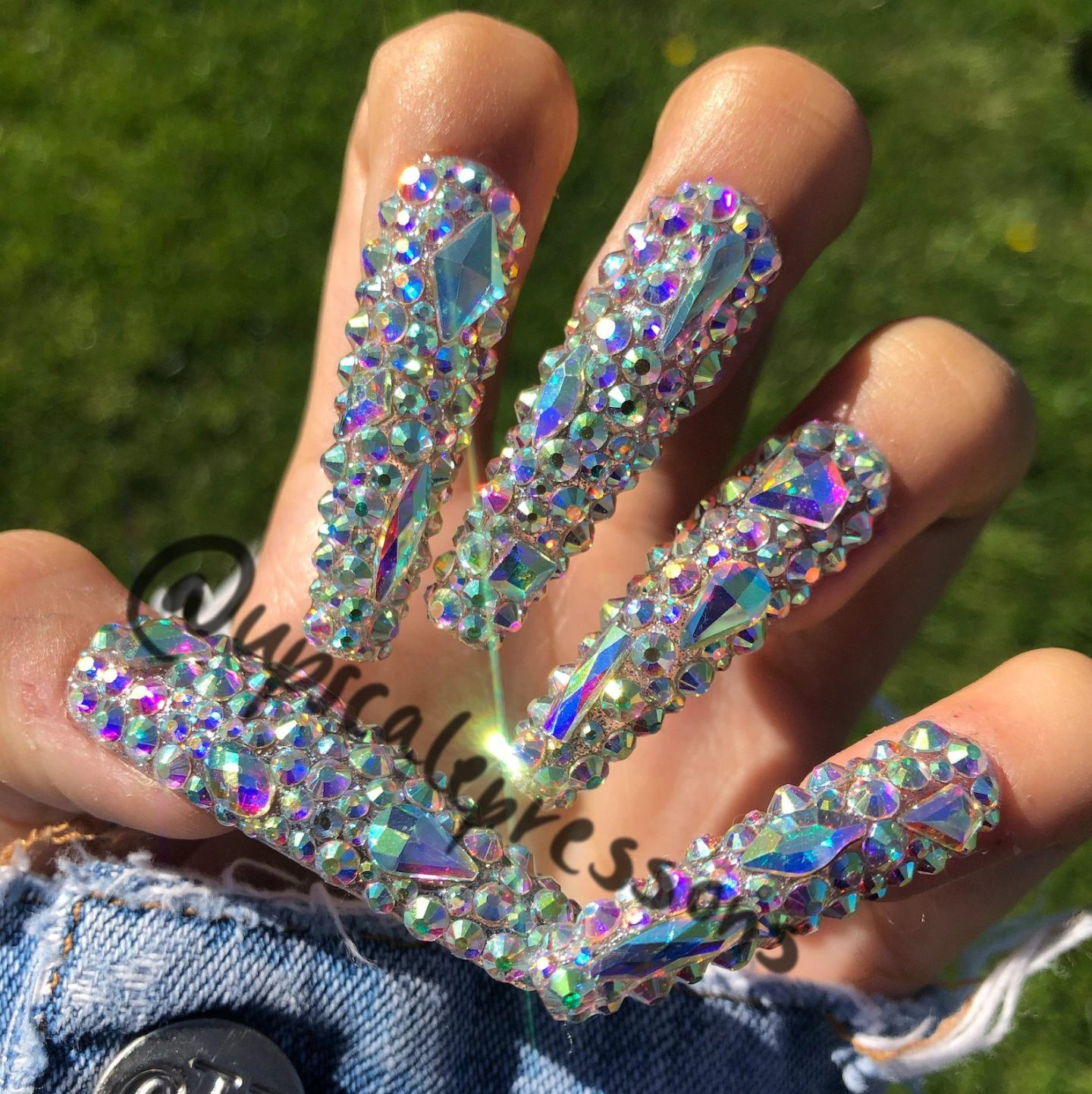 Long rhinestone nails with crystals in coffin shape