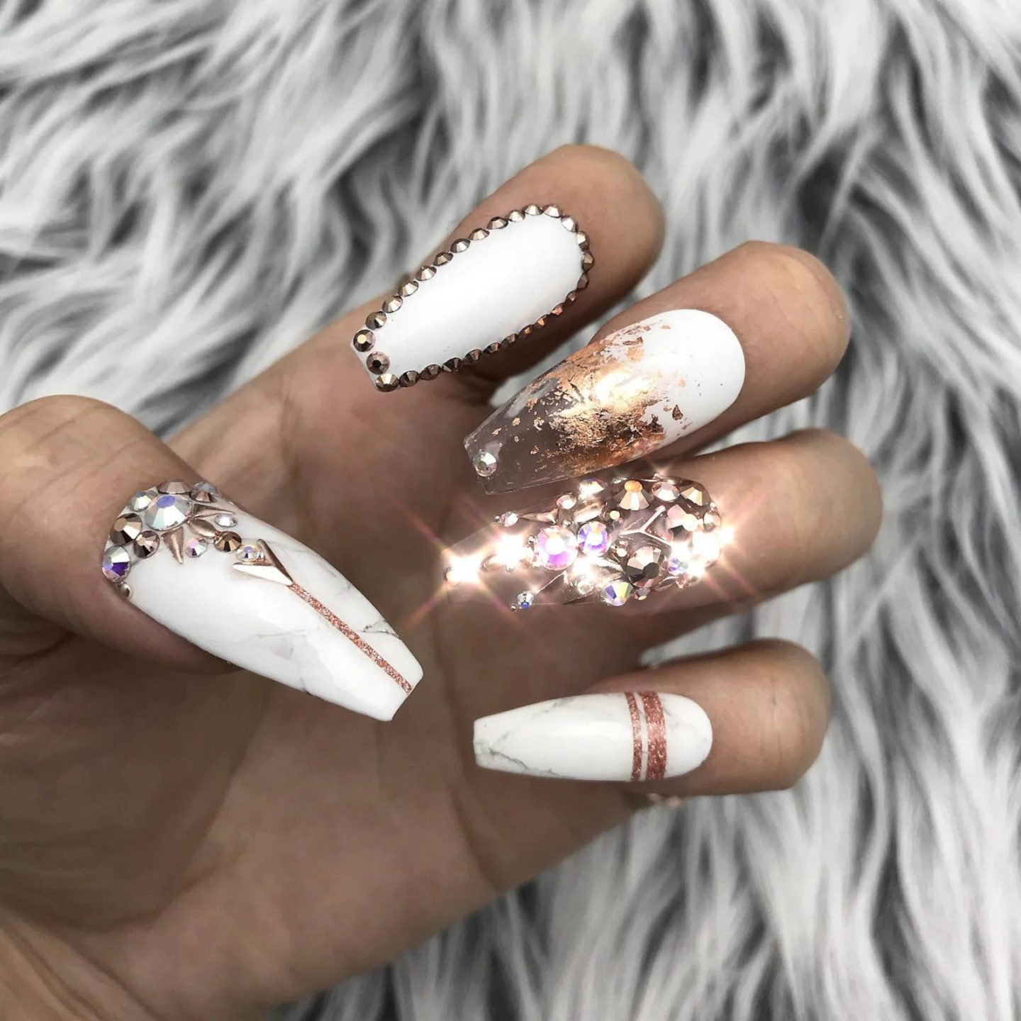 Matte white nails with rose gold foil and crystals