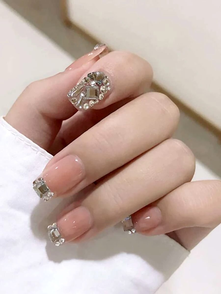 Short nude nails with rhinestones