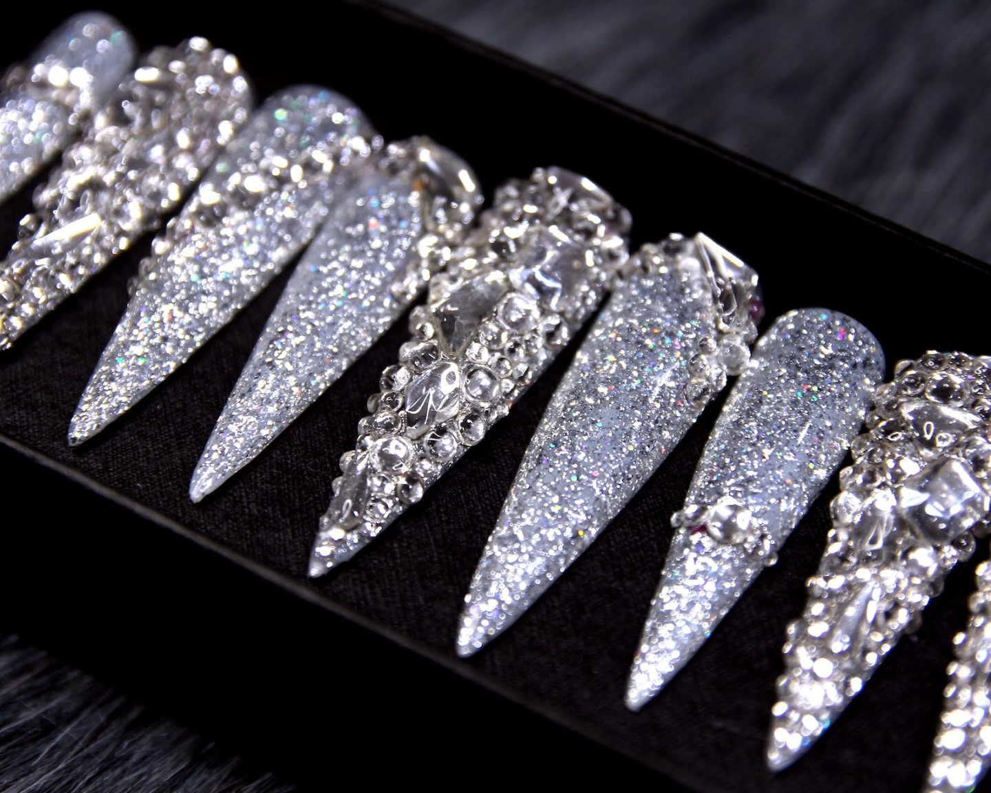 Long silver stiletto nails with rhinestones