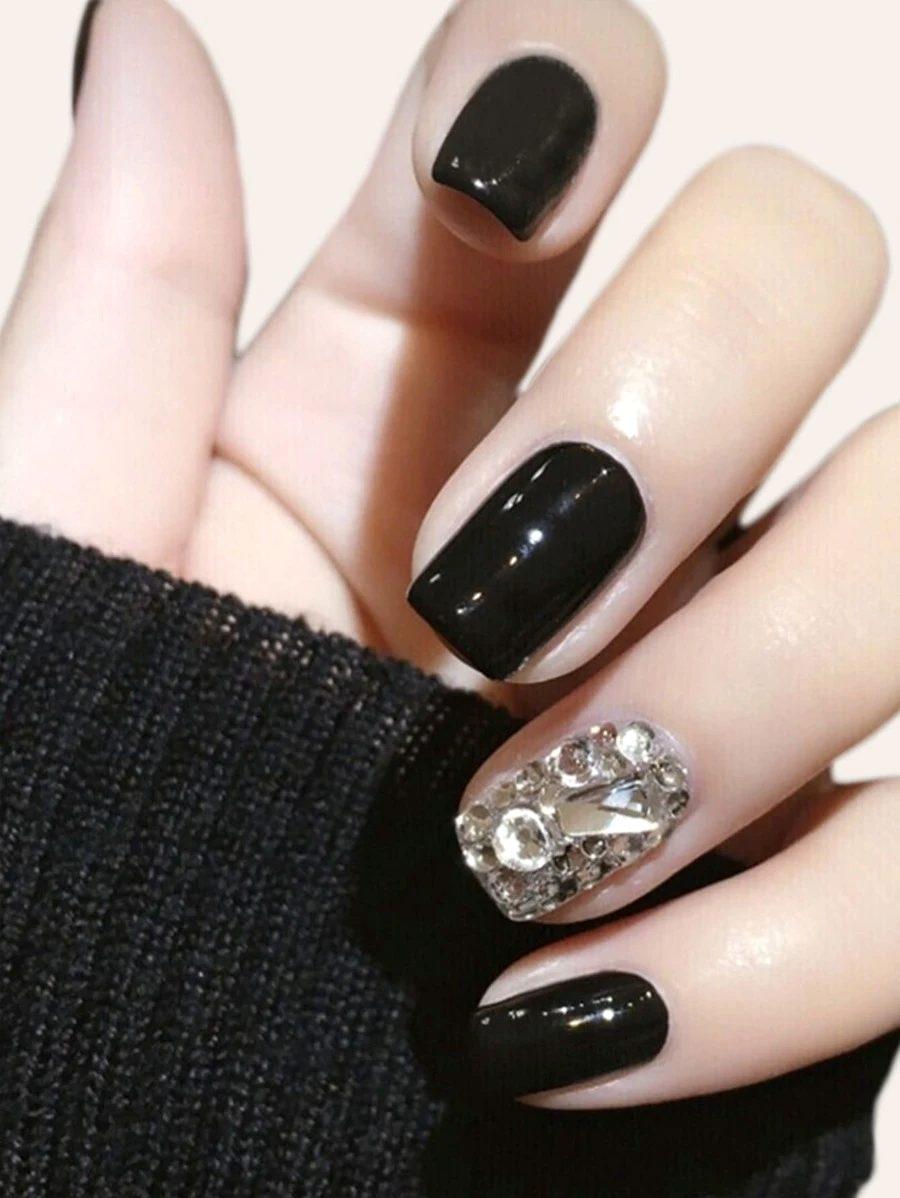 Short black nails with rhinestones