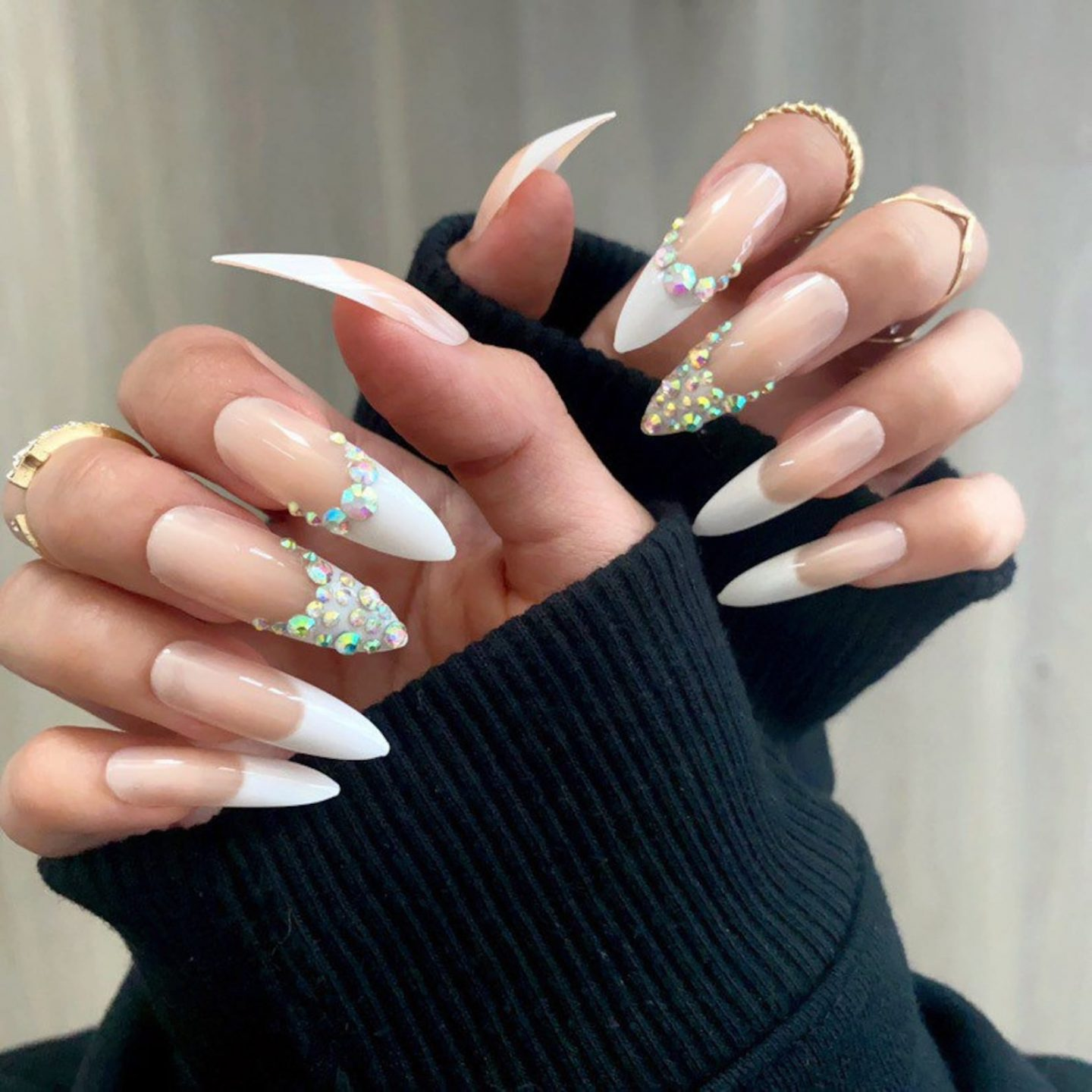 Long French tip nails with rhinestones