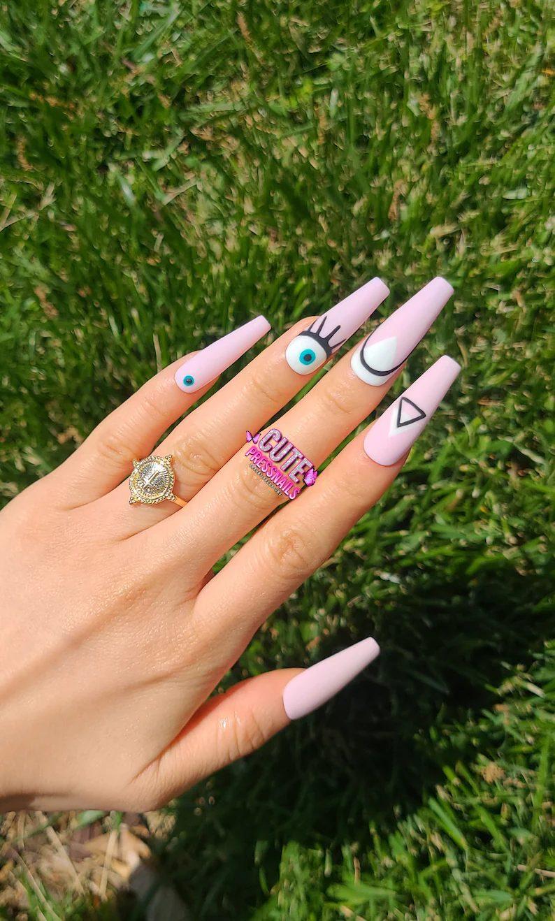 Long matte pink evil eye nails