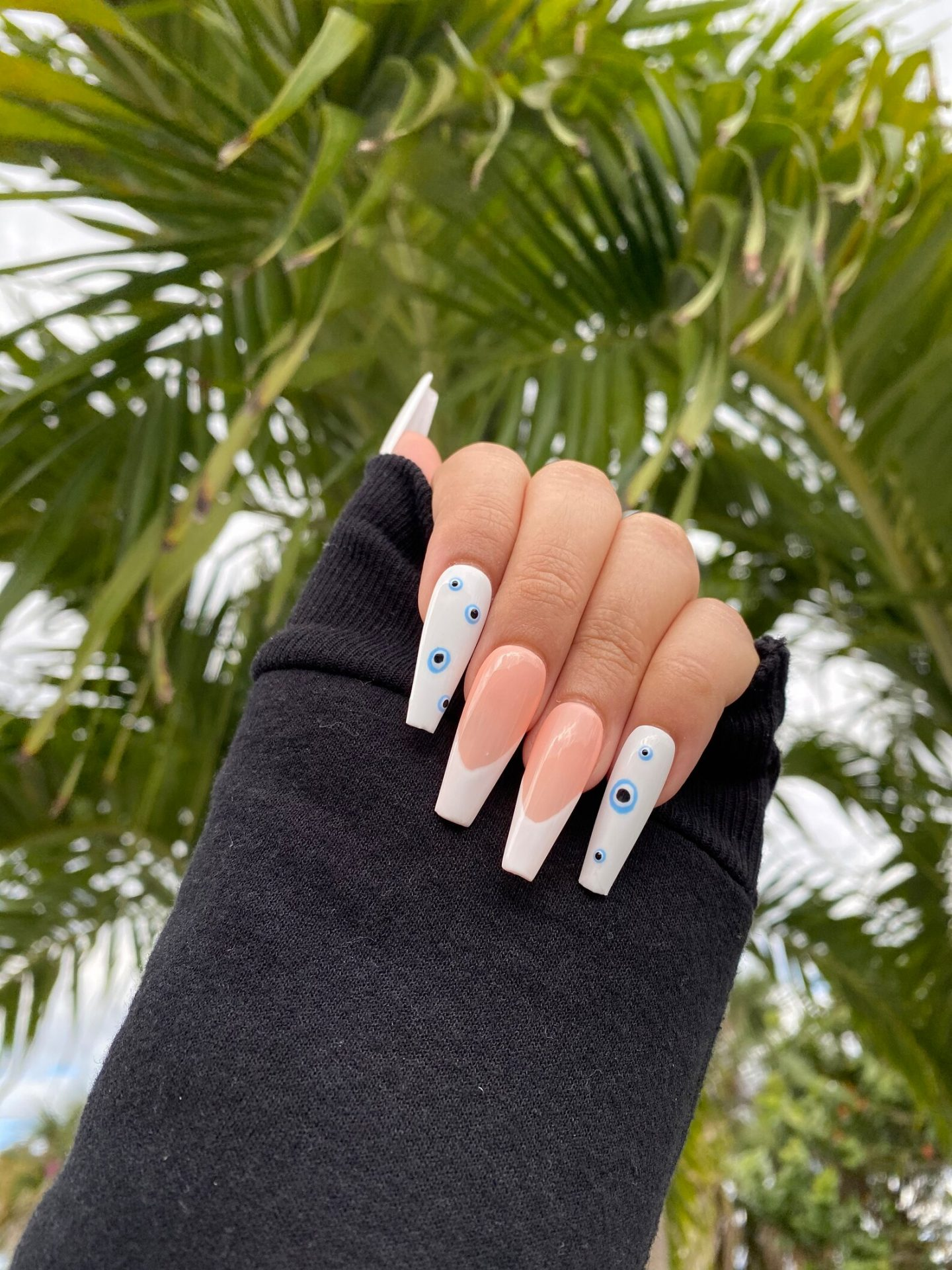 White French tip nails with evil eye