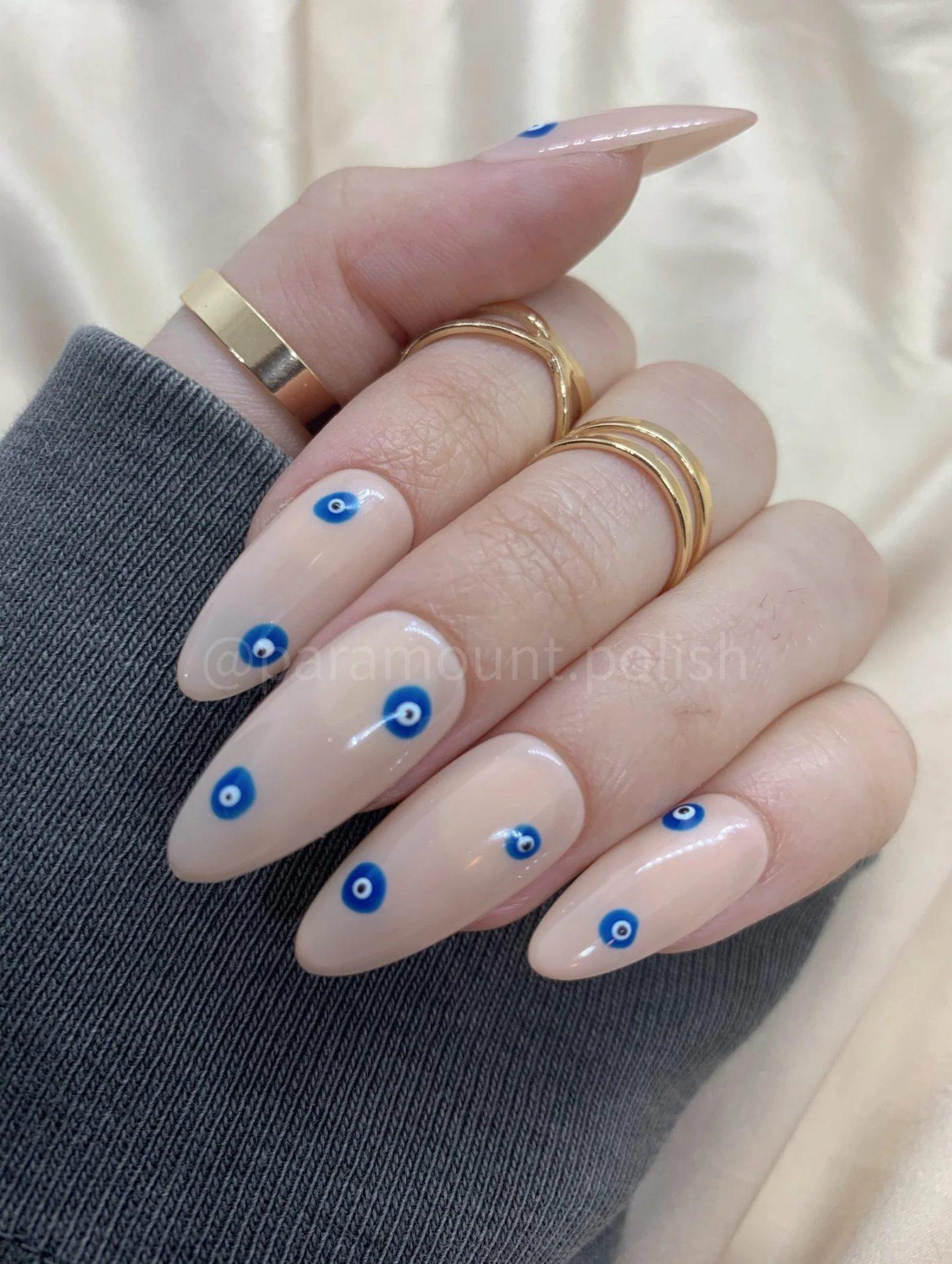 Minimalist neutral evil eye nails in almond shape